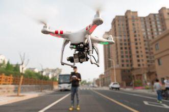Drone-Flying-City-Street-Human-Pilot.jpg.653x0_q80_crop-smart